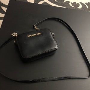 Michael Kors small gold and black purse